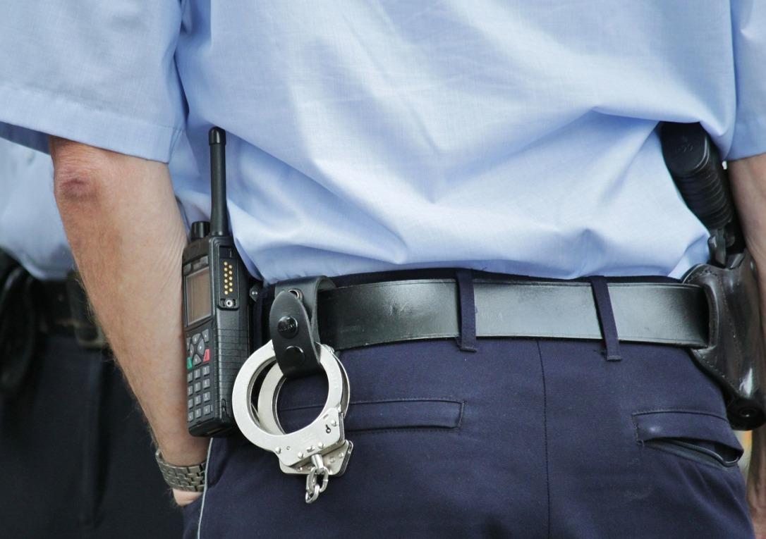 policewithhandcuffs.jpg